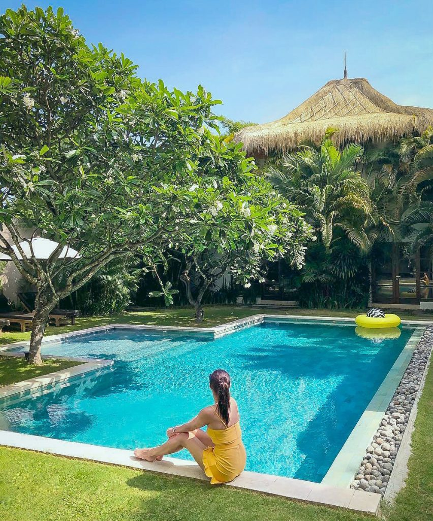 a-woman-in-yellow-dress-spend-an-afternoon-at-Villa-Chocolat-poolside